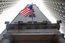 A flag flutters in the wind outside the New York Stock Exchange
