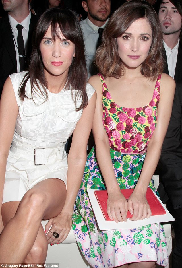 Sitting pretty: Kristen Wiig in the Marc Jacobs collection crowd wearing a short white all-in-one suit with Rose Byrne in a flowery print dress
