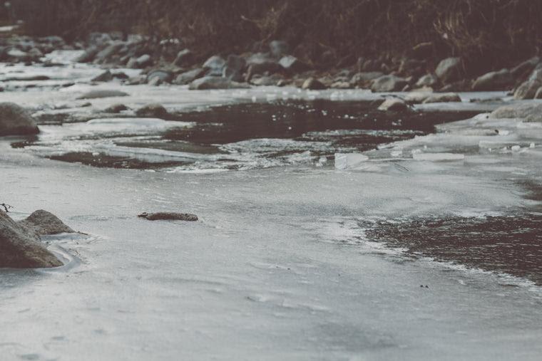 Photo of Boulder Creek frozen during winter