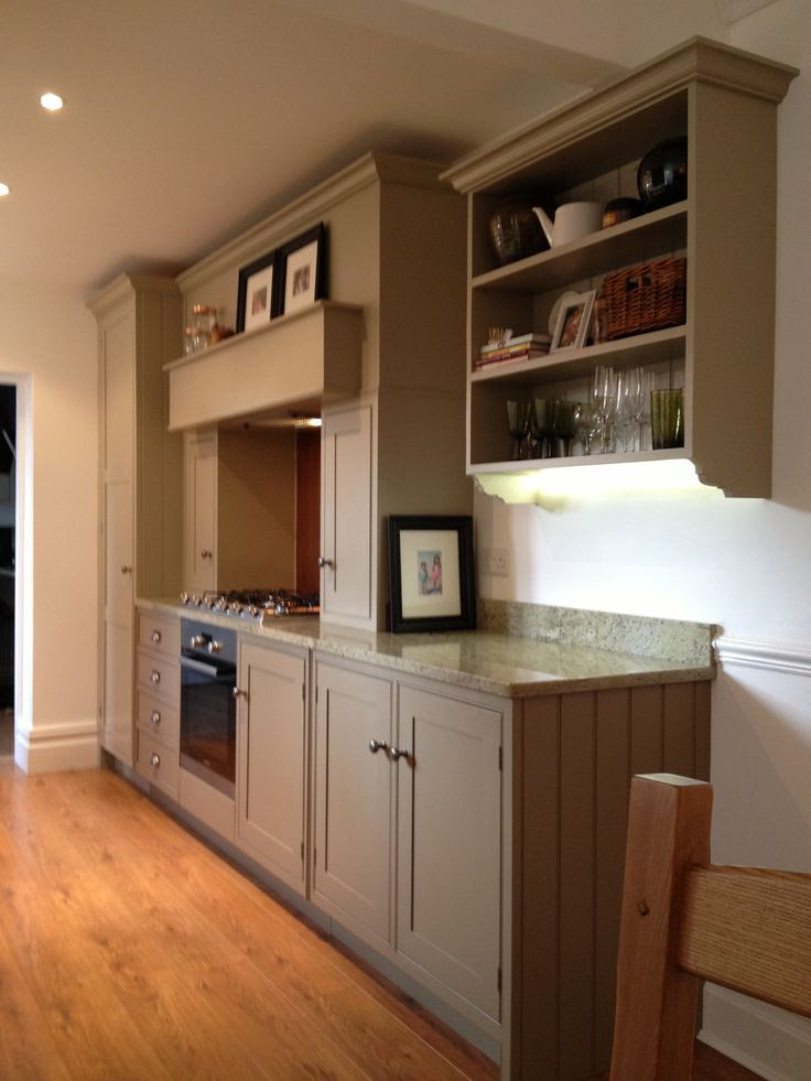 Farrow and Ball Mouses Back lowers, lightened Light Grey uppers, surf green granite, copper back splash. Medium oak floors.