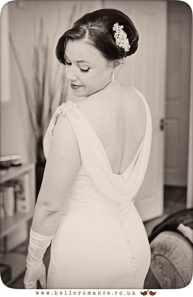 Bride looking over shoulder in beautiful vintage dress - www.helloromance.co.uk