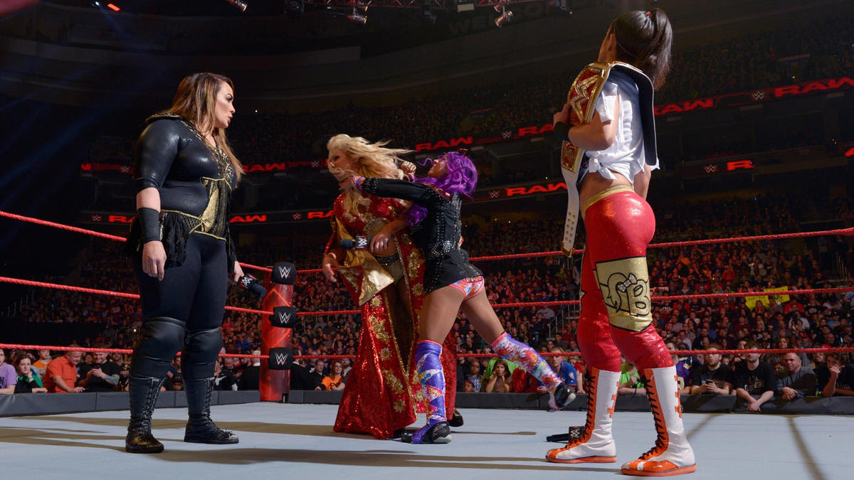 Banks attacks Charlotte prior to the start of the tag team match.