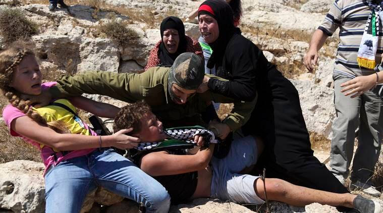 ahed tamini, palestine teen, israeli soldier slap, israeli military court, world news, protest, indian express