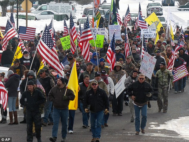 Protesters march on Court Avenue in support of an Oregon ranching family facing jail time for arson in Burns, Oregon, on Saturday. Soon after, they occupied Malheur National Wildlife refuge building in Princeton, Oregon