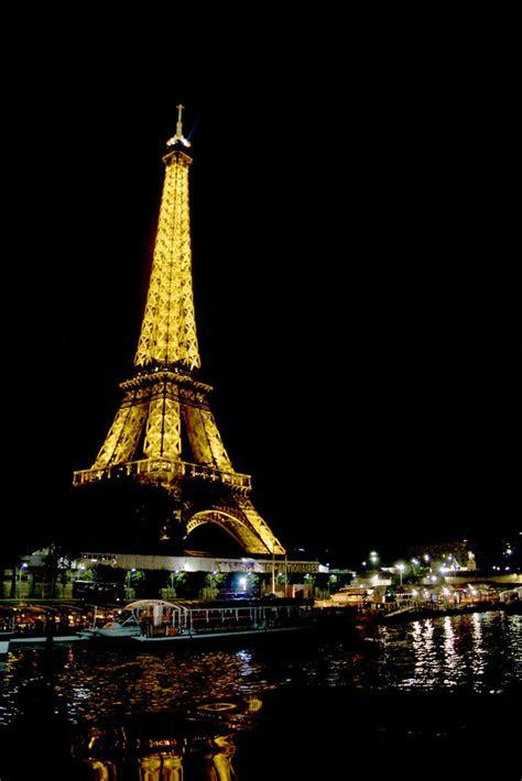 torre eiffel de noche desde el rio sena eiffel tower