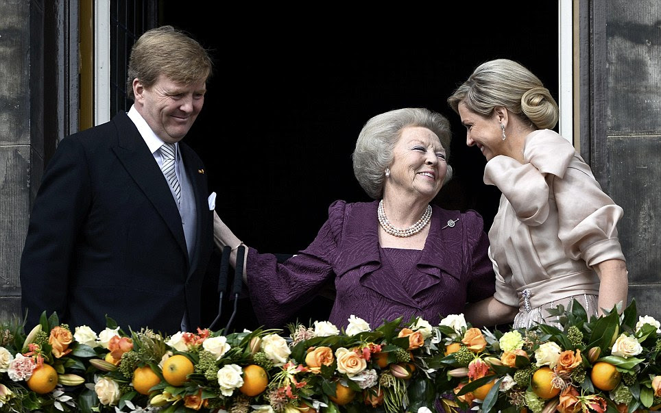 Gesture: Princess Beatrix embraces her son and his wife. The celebrations will continue throughout the day
