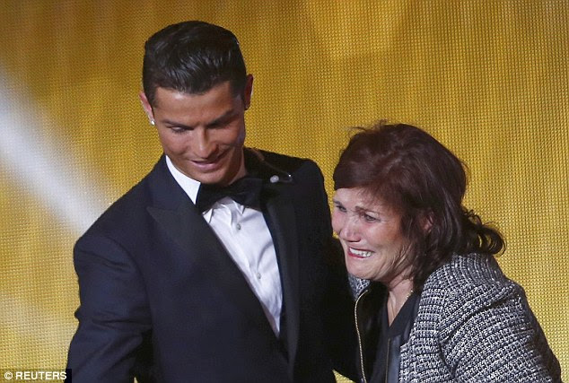 Family man: Cristiano was accompanied by his mother, Maria Dolores dos Santos Aveiro on stage