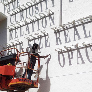 Typographic Shadow Graffiti Turns Boring Building Into Ever Changing Masterpiece