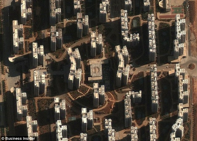 Desolate: These skyscraper in Chenggong, where there are already 100,00 new homes, should be bustling with life but are instead empty