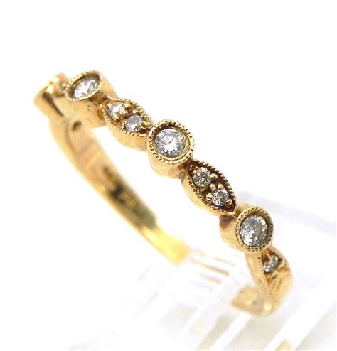 stackable ladies  yellow gold diamonds wedding ring