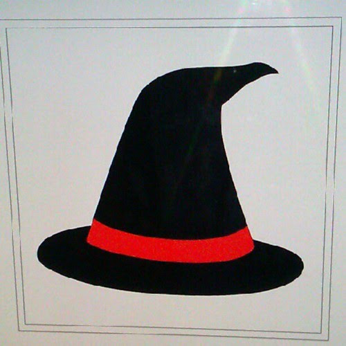 Working on ideas for the Halloween paper piecing blog hop. A witches hat? Or...