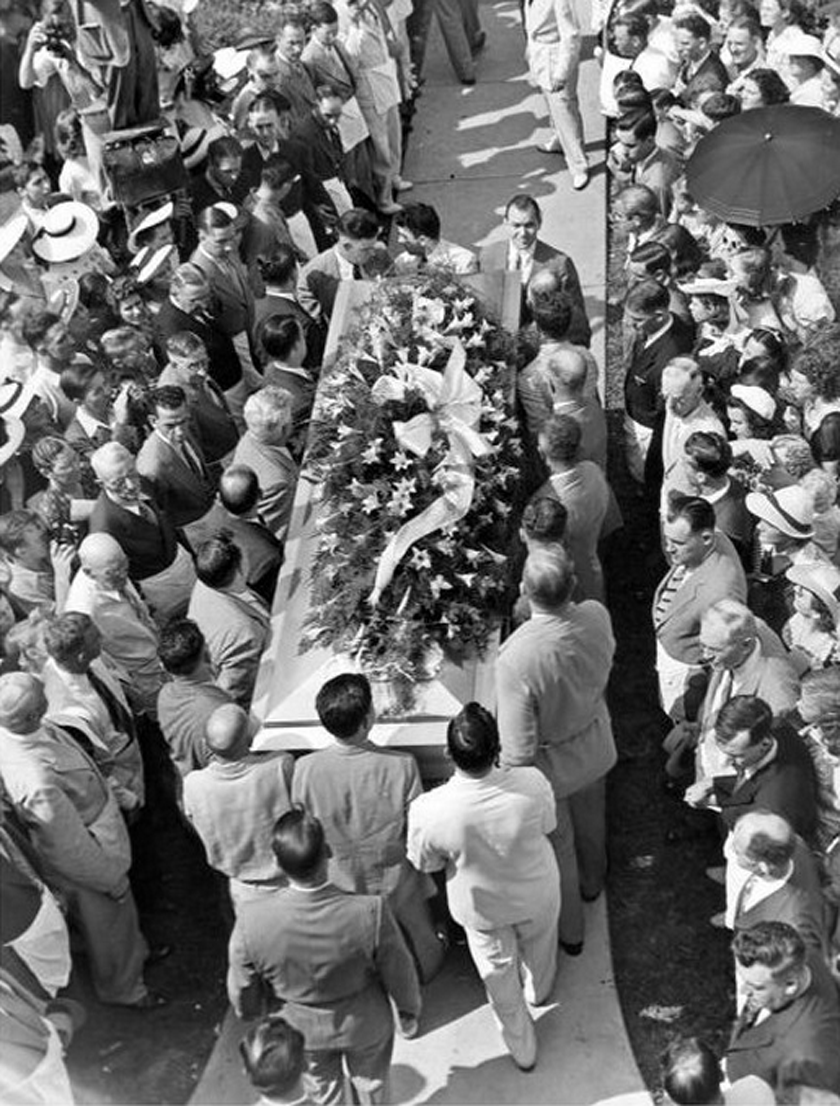 """Wadlow's 1,000-pound casket required 18 pallbearers and was carried to his final resting place in his hometown of Alton, Illinois. Wadlow's family decided to destroy most of his belongings for fear that his personal effects would be collected and displayed as """"freak"""" memorabilia."""