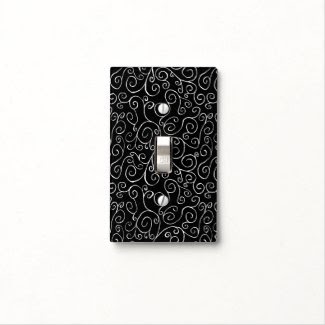 White Scrolling Curves on Black Light Switch Plate