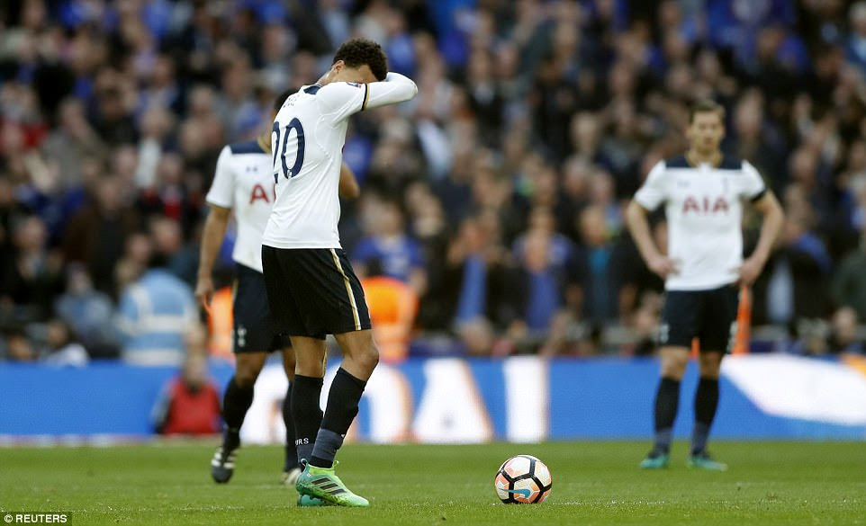 Dele Alli looks despondent on the centre circle after Hazard's goal sent Chelsea 3-2 up just 15 minutes before full-time