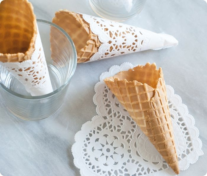 waffle cones wrapped with paper doilies ... simple and sweet!