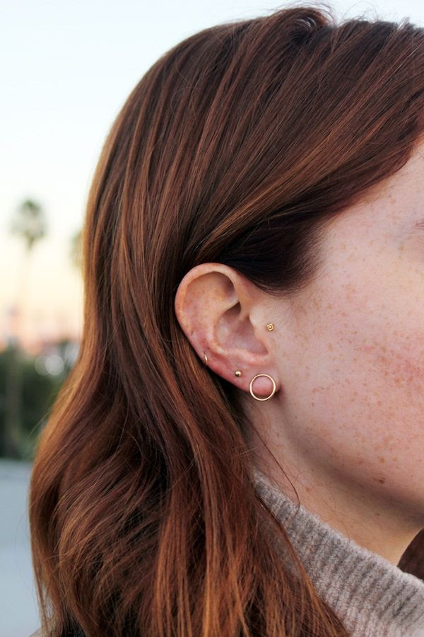 Le Fashion Blog Multiple Piercings Looks Red Hair Mini Stud Jewelsmith Round Open Earring Small Thin Helix Side Hoop Model Libby Strachan Ribbed Turtleneck
