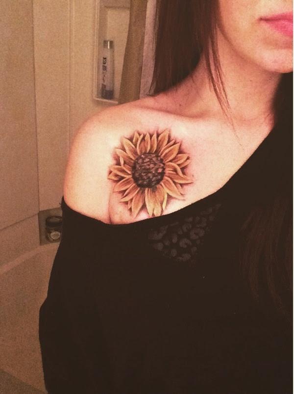 Grey Ink Sunflower Tattoo On Front Shoulder