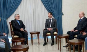 Bashar al-Assad, centre, is joined by security chief Ali Mamlouk, right, at a meeting with Iranian parliamentarians. Mamlouk is accused of providing Samaha with explosives.