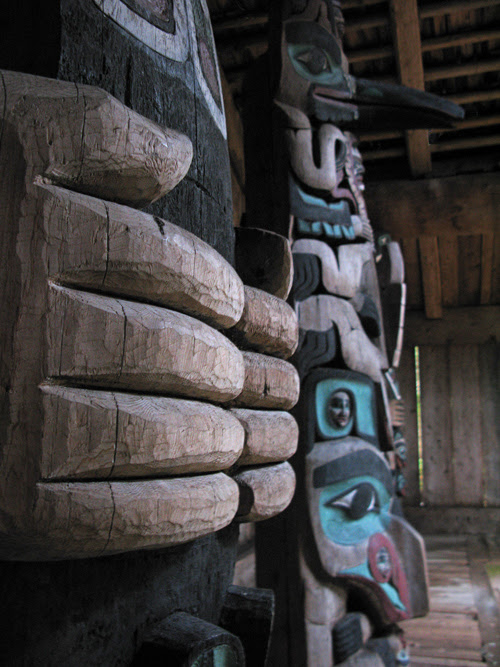 house posts inside Chief Son-i-Hat Whale House, Kasaan, Alaska