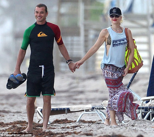 In love: Gwen and husband Gavin Rossdale share on the beach while on vacation in Palm Beach, Florida at the weekend