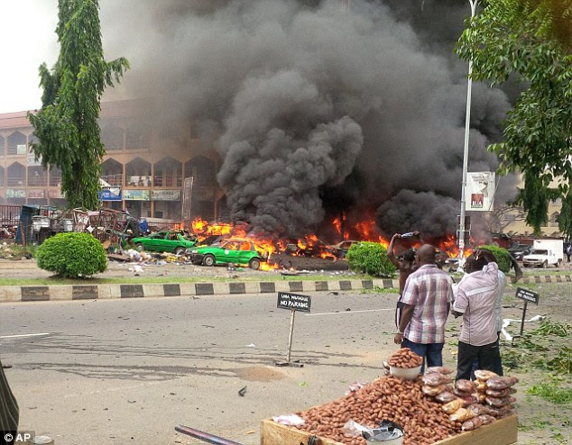 Devastating: An explosion believed to have be linked to Boko Haram killed at least 22 people in a shopping mall in the Nigerian capital Abuja yesterday