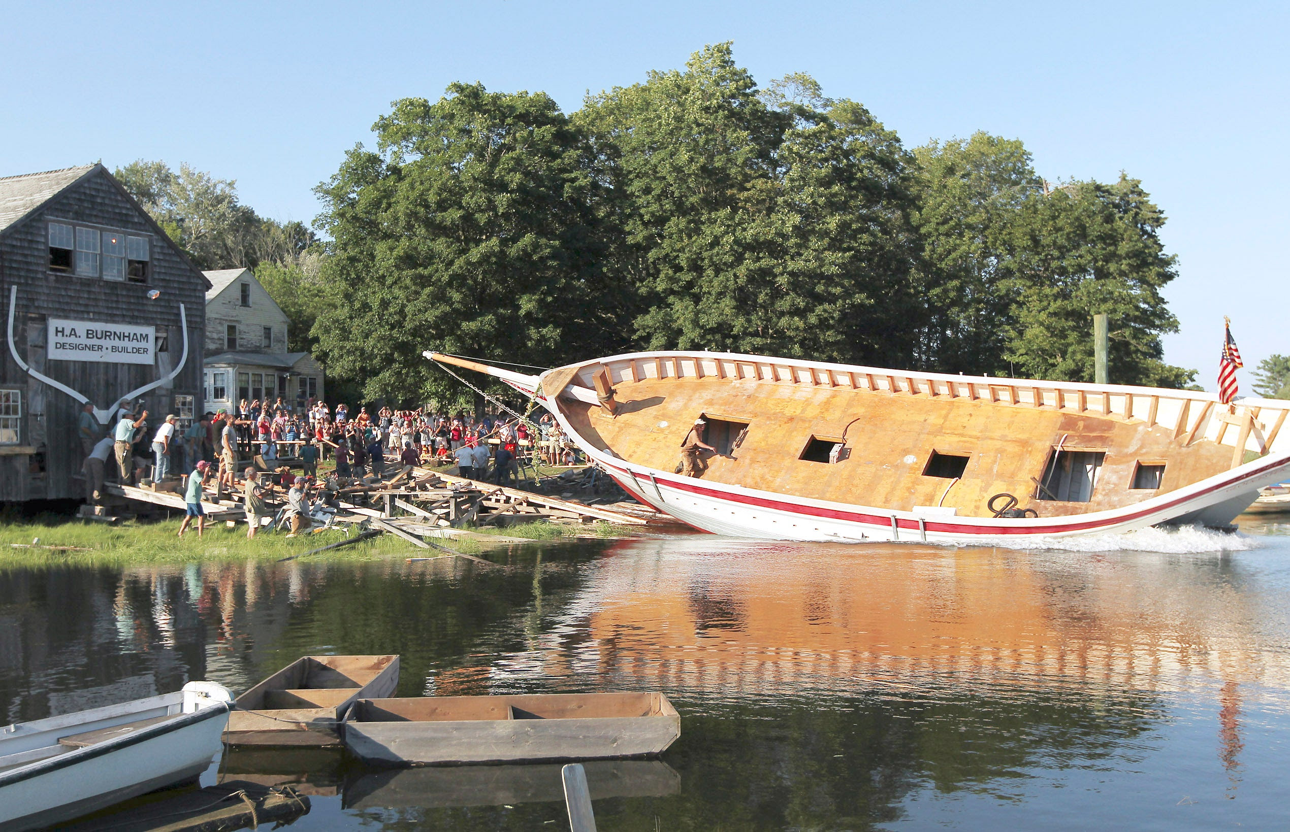 Harold Burnham built the 55-foot Ardelle, shown being launched last summer. Burnham was docking the schooner last week when             he received news of the award.