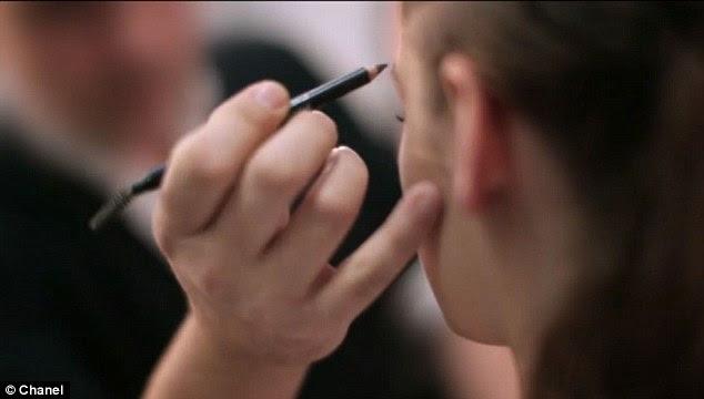 American girl: Kristen's eyes get the kohl treatment