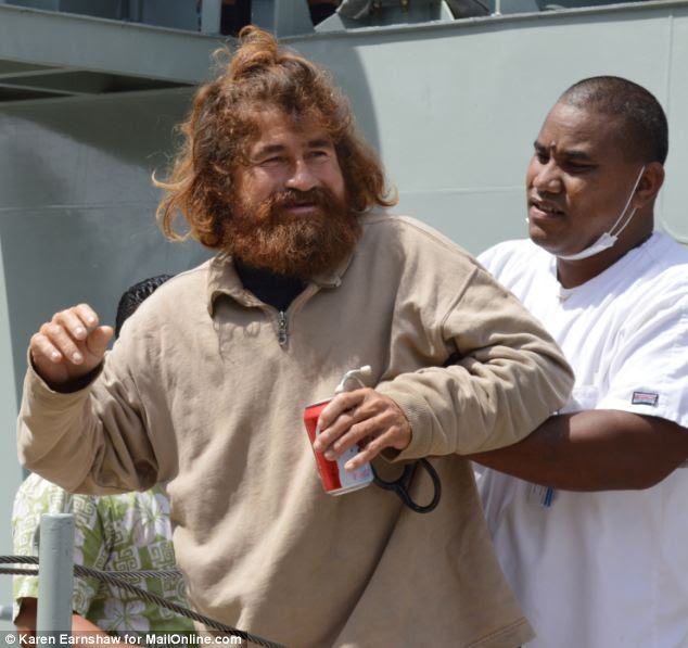 Alive! The first picture of Jose Salvador Alvarenga, still with his tangled hair and scraggy beard, as he arrives in Marujo, in the Marshall Islands after 14 months adrift at sea. He looked plumper than expected - but doctors say his body could be swollen from the conditions he endured