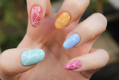 This multi-colored line design is so cute for summer nails!
