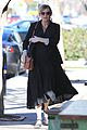kirsten dunst cradles baby bump while shopping 04