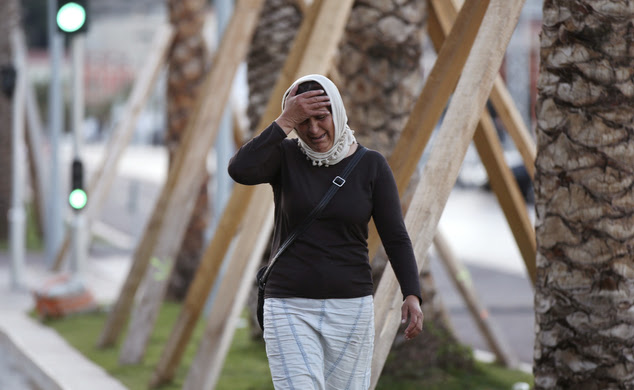 A woman cries asking for her son as she walk near the scene of an attack after a truck drove into the crowds in Nice