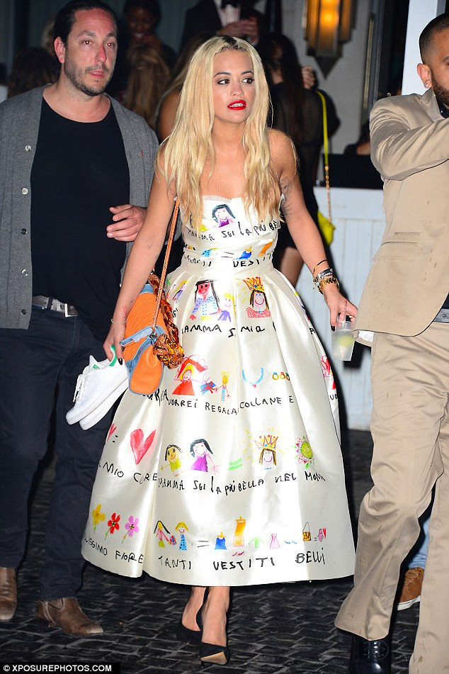All dressed up! Rita Ora chose a designer dress splattered with children's illustrations for her New Year's Eve in Miami, where she hit South Beach's Twist club with her celeb pals