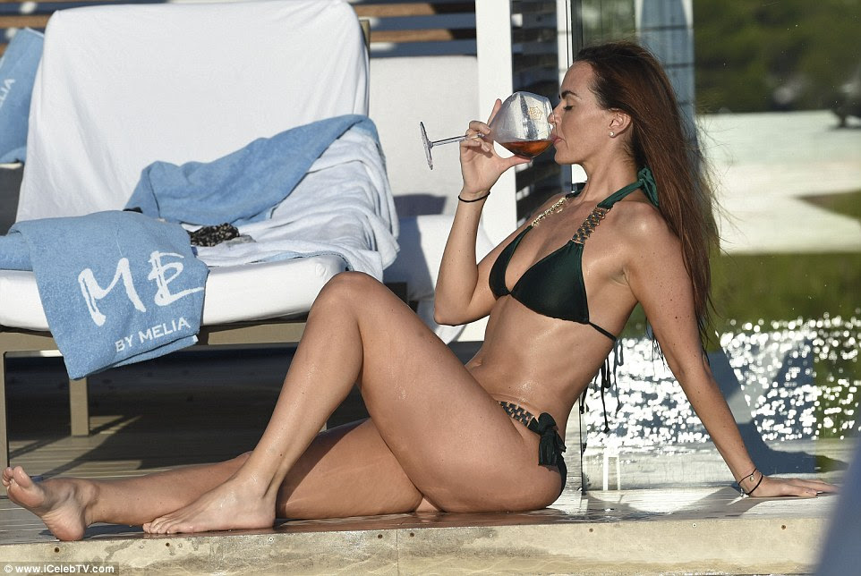 Loving life: Jennifer seemed in pure bliss as she sipped her drink by the side of the pool