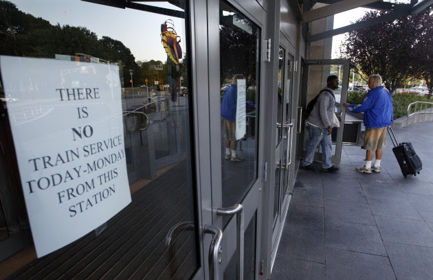 Travelers walk through doors at the Trenton train station early Monday, Aug. 29, 2011, in Trenton, N.J., without seeing a sign that says there is no train service. New Jersey Transit rail service was