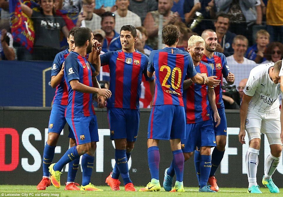 Luis Suarez is congratulated by team-mates as Barcelona ran riot against Leicester during the first-half in Stockholm