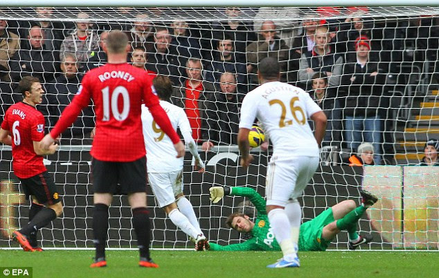 All square: Michu scores the equiliser for Swansea