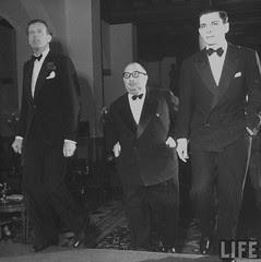 Austrian Baron Hans Doblhoff, Egyptian Prince Abu El Moneim and Peter Zervudachi spending the evening at fashionable winter resort.st. Mortiz 1946