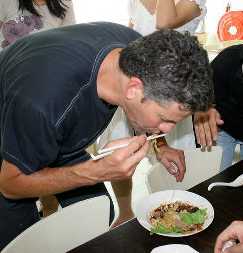 Bob trying out bak chor mee (minced meat noodles)