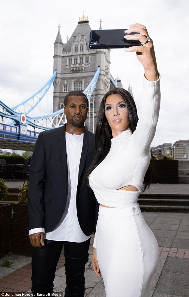 Kanye West's wax figure wears leather trousers and a smart blazer, while Kim Kardashian's figure wears a dress donated byJonathan Simkhai, which the real-life socialite has been snapped in before