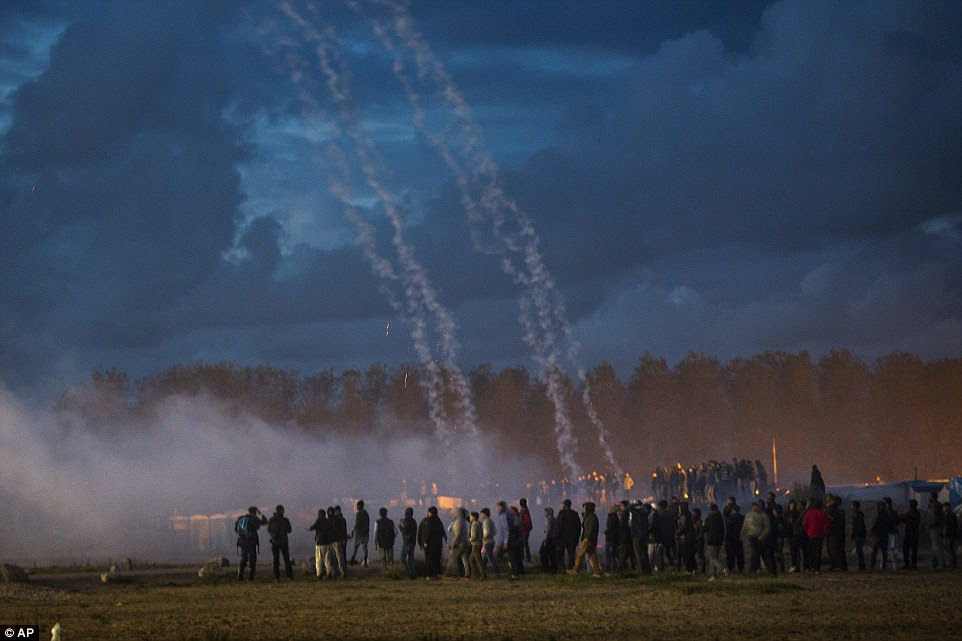 A 50-strong mob of frustrated young men threw missiles at the officers who responded with tear gas and baton charges