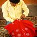 Sumar Daud applying castor oil gum