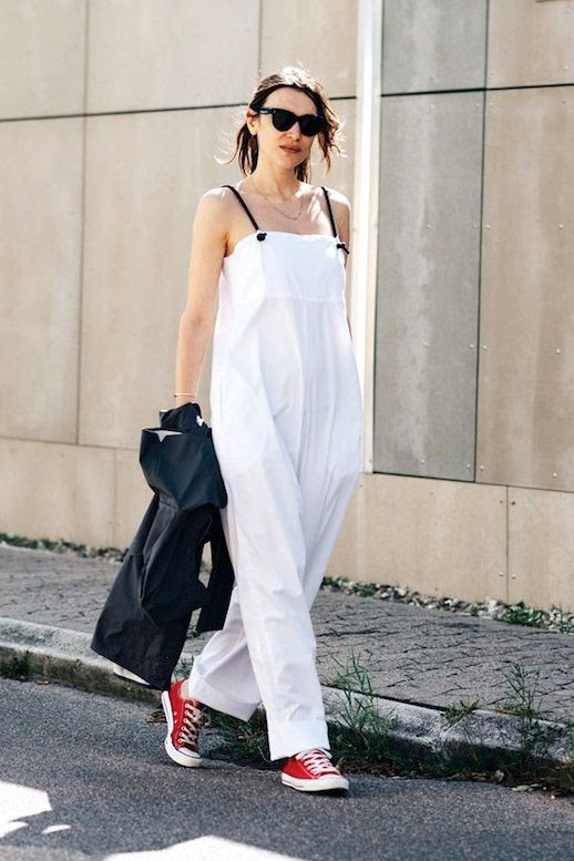 Le Fashion Blog Street Style Cfw Sunglasses White Sleeveless Jumpsuit Black Blazer Red Converse Sneakers Via British Vogue