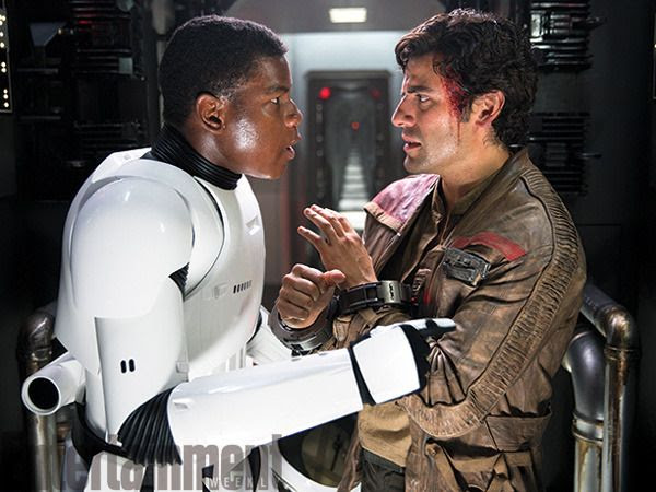 Finn (John Boyega) and Poe Dameron (Oscar Isaac) work together to escape from a First Order Star Destroyer in STAR WARS: THE FORCE AWAKENS.
