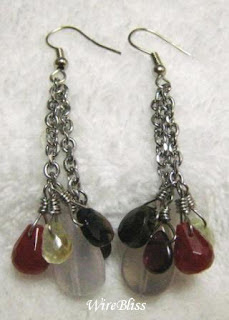 wire wrapped dangle earrings with garnet