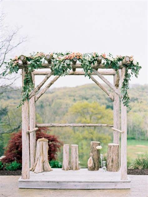 rustic tree stump wedding arch ideas   Tree stump