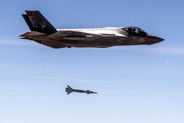 An F-35C Lightning II drops an inert GBU-12 Paveway II smart bomb onto a moving target at Naval Air Weapons Station China Lake in California...on March 29, 2017.
