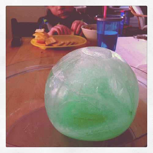 We made a green ice ball (with green food coloring + water in a balloon). Now the boys are watching it melt inside.