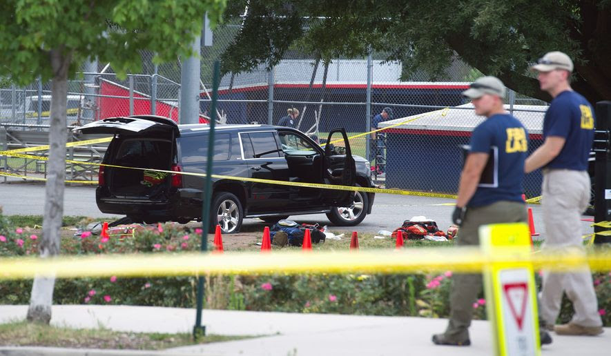 An SUV at the ballfield had a bullet hole in the windshield and a flat tire after the gunman shot at a U.S. Capitol Police officer who was returning fire to protect the lawmakers. (Associated Press)