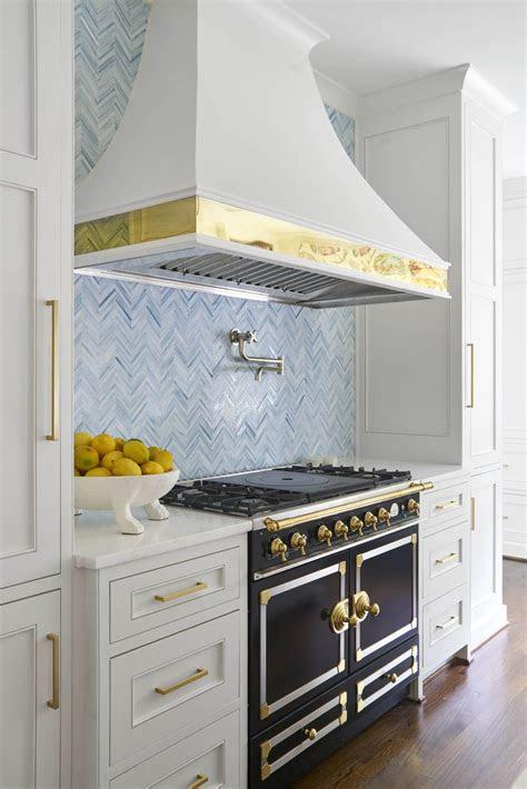 light  bright kitchen  white cabinets  brass