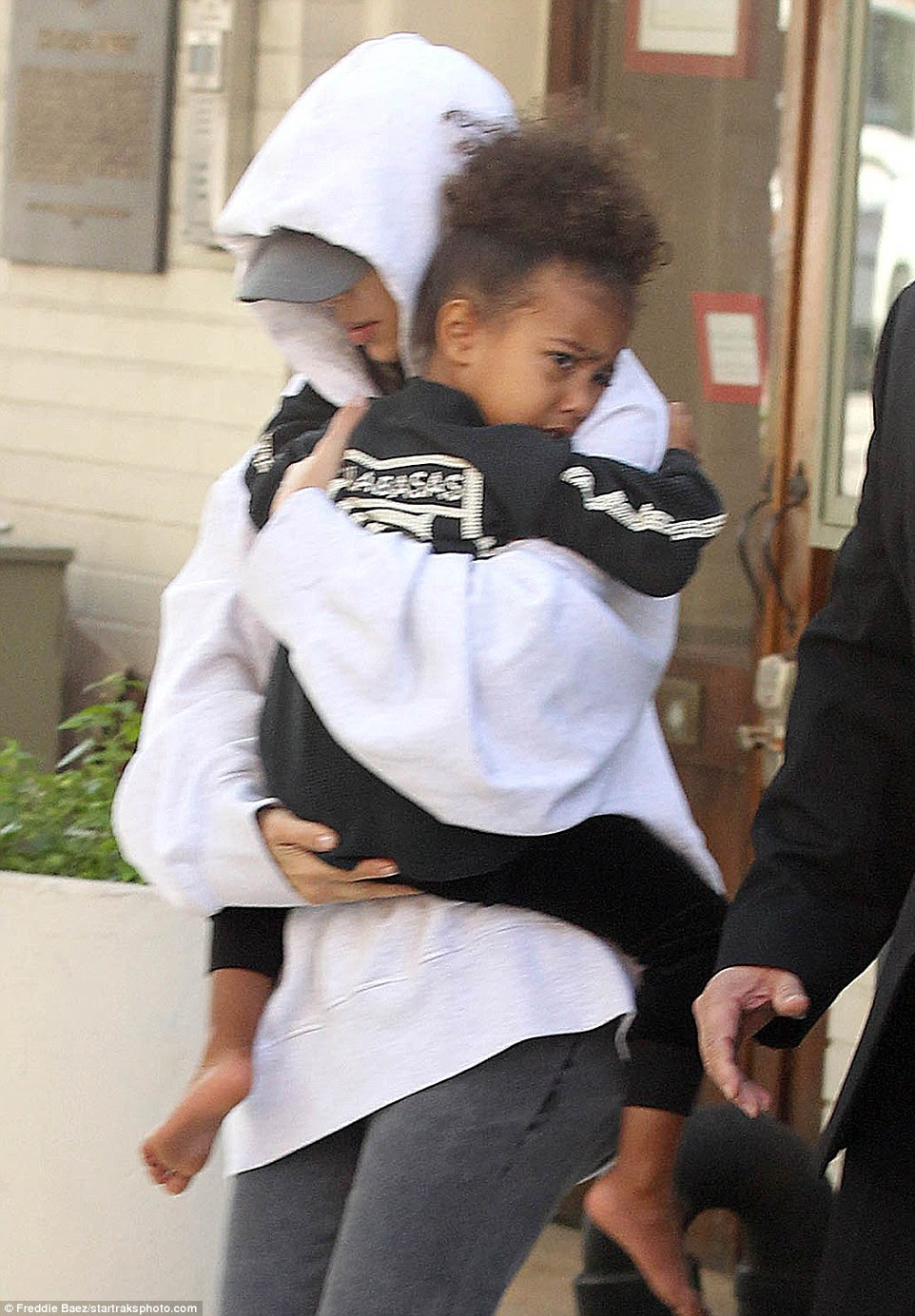 Shaken:Kim Kardashian was surrounded by her loved ones on Thursday afternoon as she emerged from her New York City apartment ¿ three days after being robbed at gunpoint in Paris